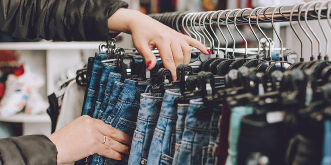 a woman shopping for jeans